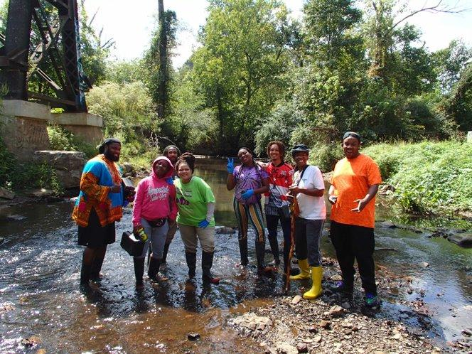 A group photo of volunteers in the stream before monitoring.