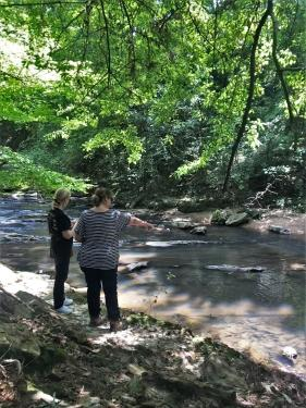 A picture of two volunteers conducting a visual habitat survey.